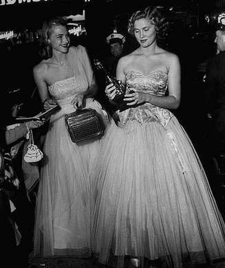 Miss America Colleen Kay Hutchins (R) looking at her trophy, September 1952.